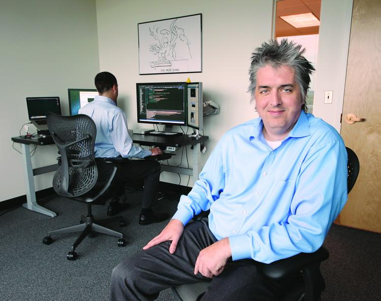 Henry Gnad is president and CEO of Rough Stone Software. Gnad has invested in high-end workstations and equipment in an effort to attract and retain employees.