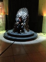 "Fans of HBO's hit show ""Game of Thrones"" lined up at the afterparty at the Experience Music Project (EMP) in Seattle to have photos taken in the ""Iron Throne,"" a piece from the show's set."