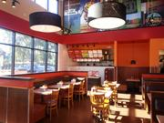 The interior of the new Lincolnwood Meatheads has seating for 68 on the main floor and 26 on a mezzanine level.