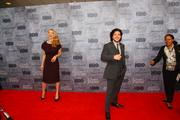 "Actors Natalie Dormer and Kit Harington, who play Margaery Tyrell and Jon Snow on HBO's hit series ""Game of Thrones,"" react to fans outside the window of the Cinerama theater in Seattle."