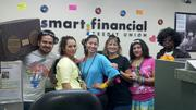 """Smart Financial Credit Union is a 2013 Best Places to Work finalist. The firm says """"Celebrate"""" is a good theme song because they do like to celebrate. This photo is of a group of employees that won the annual Halloween costume contest with their '80s style."""