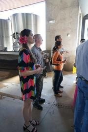 Amanda and Eric Kelley of UMB and Chris Wettig and Lindi Lanie listen as a Cade guide describes how and when barrels are filled with what will become wine.