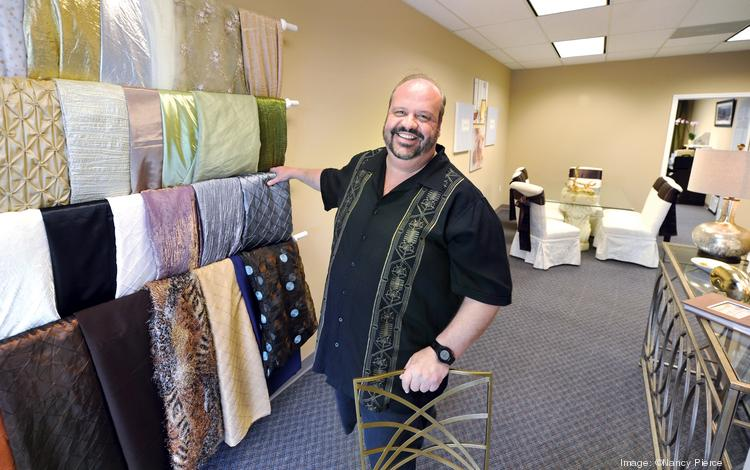 Armin Desch shows off the table linens used by his catering business.