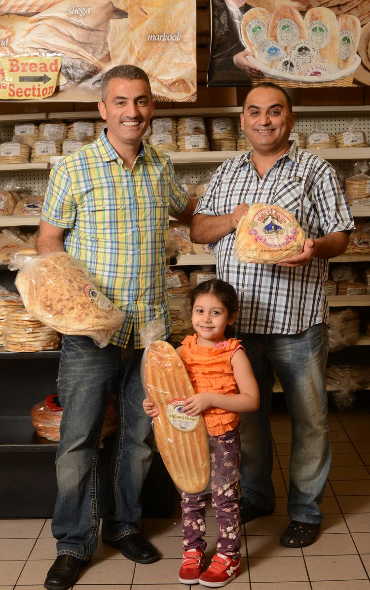 Majdi Wadi, left, the CEO of Holy Land Bakery & Deli, with brother and co-owner Wajdi WAdi and niece Juamana, age 4. The company sells through its stores and chains like Target.