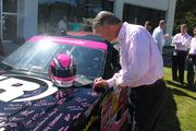 Scott Krull, president of the Americas for Ingersoll-Rand Industrial Technologies, signs the No. 44 car.