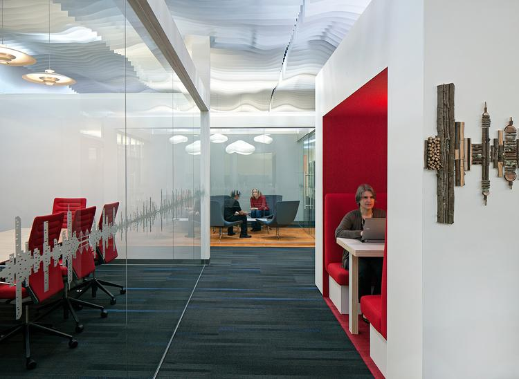 A photo inside the Gensler-designed Santa Cruz campus of Plantronics, which blends depersonalized open office space with semi-private booths, enclosed meeting space and conference rooms.