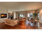 The family room has an Empire marble gas fireplace and a view of Lake Minnetonka.