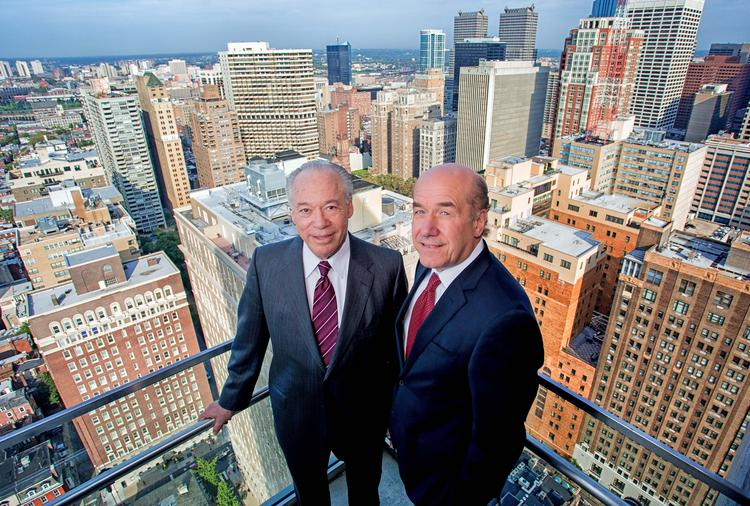 Joe Zuritsky (L) and Tom Scannapieco on the balcony of the final unit under construction which has been sold at 1706 Rittenhouse in Philadelphia.