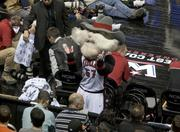 A mascot rocks out in the stands.
