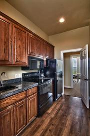 The offices includes a kitchenette with new appliances and wood flooring.