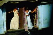 Prostitutes, who are known as cage girls and are often sex slaves, display themselves on a Mumbai street.