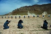 Women—mostly widows—train for police force jobs at a firing range near Kabul.