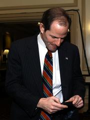He wore a pager and so did you: Then-New York State Attorney General Eliot Spitzer checks his pager before speaking at the Fortune Global Forum in Washington, D.C., in November 2002. Dennis Brack/ Bloomberg News.
