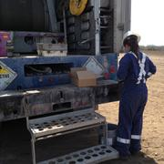 Marisa Manning, Baker Hughes engineer, working on core samples.