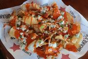 Another dish from Drake's buffalo blue chips, a mound of house-fried extra thin potato chips, dripping in bleu cheese dressing and hot buffalo sauce.