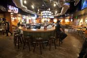The 5,500 square-foot restaurant has a bar in the front room and another in the back room.