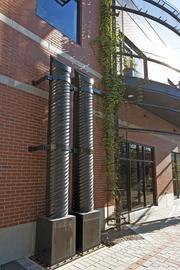 The two columns outside the Highland Green Building serve as a rainwater collection system.