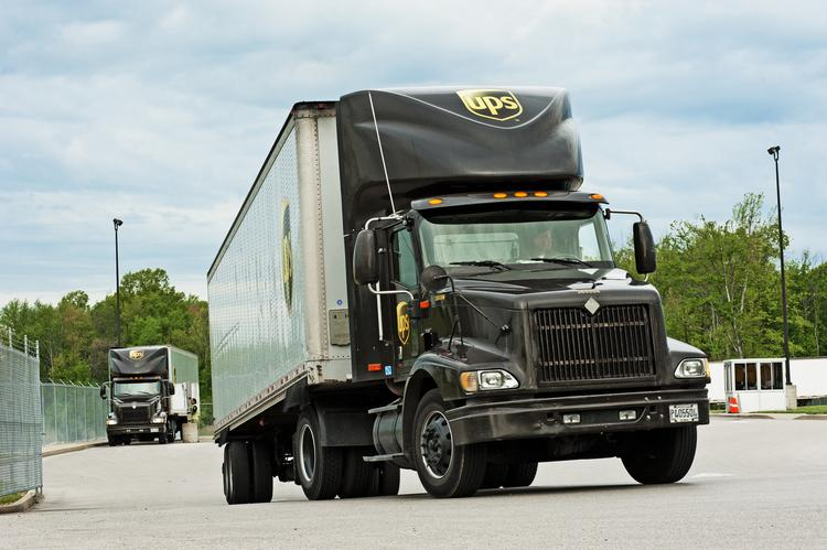 UPS trucks are shown leaving the company's Renaissance Park operation in Louisville.