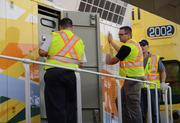 Technicians make some systems checks before disembarking.