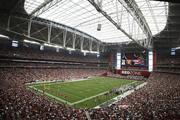 University of Phoenix Stadium in Glendale, Ariz., has a roof that can open and a natural grass playing field that can be moved outside the stadium.