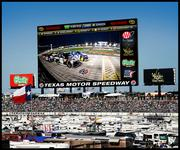 """Texas Motor Speedway plans to build a screen, nicknamed """"Big Hoss,"""" that is 218 feet across and 95 feet tall."""