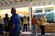 A crowd soon gathers by the tracks as SunRail staff are on hand to answer questions.