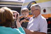 Peggy McWhertor of Winter Springs takes a photo of husband Joe and grandson Jack Doden by the locomotive.