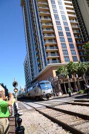 An Amtrak passenger train passes by during the preview.