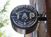 """This Commonwealth Tap sign hangs outside the front door of then new wine """"studio."""""""