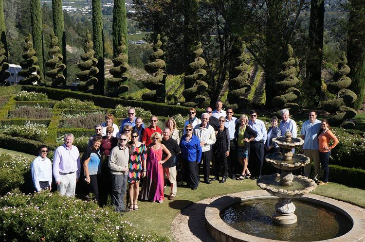 The gardens provided a beautiful setting for a Best in Business group photo.