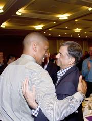 Sacramento Mayor Kevin Johnson hugs Sacramento Kings majority owner Vivek Ranadive.