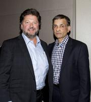 Thomas Kandris, CEO, American Packaging Company poses with Sacramento Kings majority owner Vivek Ranadive.