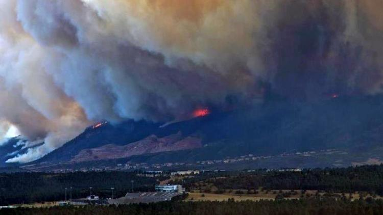 The Waldo Canyon fire burns out of control in Colorado Springs in this photo released to the media on Aug. 22, 2012. The United States Air Force Academy grounds are in the foreground.
