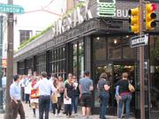 The line at Philadelphia's first ShakeShake (2000 Sansom St.), June 2012. ShakeShack, which is part of New York City-based Union Square Hospitality Group, will open at 3200 Chestnut St. in Philadelphia on Oct. 11. It has a year-old location at 2000 Sansom St. and is opening a King of Prussia, Pa., restaurant on Oct. 21.