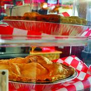 The Little Red Barn not only specializes in serving steaks but the restaurant sells pies too.
