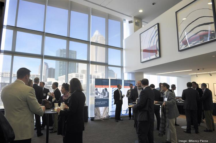 Attendees network before the Charlotte Business Journal's CREQ Live event, held Friday at the UNC Charlotte Center City Campus. The event, tied to the CBJ's Commercial Real Estate Quarterly publication, is hosted in partnership with the Charlotte Region Commercial Board of Realtors and offers an in-depth look at news and trends in the industry.