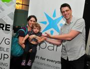 Joe Goggins with his wife, Yael, and daughter Dalia. Joe works for Spark, a company that builds WiFi-connected devices and offices in the Uptown CoCo.