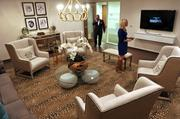 """This is the """"Living Room"""" where tenants can have a more relaxed meeting than in a conference room. Pictured again are BECO South CEO Chris Epstein and Leasing Director Mercedes Merritt"""