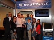 """CBJ Seen: Junior Achievement of Central Carolinas cut the ribbon last month on an improved """"Travel With Us"""" storefront in its JA BizTown in Charlotte. From left: Steve Gress, JA board vice chair; Sarah Cherne, JA president and CEO; Howard Garbee, Mike Annan, Ray Dickman and Jamie Fowler, US Airways; and JA BizTown students Matthew Dougherty, Danielle Cooper and Baily DeSouza.Want to see your events included? Send photos and caption info to aangel@bizjournals.com."""