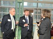 David Neer (left) of Merrill Lynch and Larry Gray of American Heat Treating speak to other guests at the 2013 DBJ Manufacturing Awards Event at the Schuster Center.