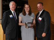 Charlie Foley (left) of sponsor Battelle & Battelle and Dave Donaldson (right) of sponsor WesBanco presented the award to Jennifer Behm of Projects Unlimited at the 2013 DBJ Manufacturing Awards Event at the Schuster Center.