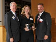 Charlie Foley (left) of sponsor Battelle & Battelle and Dave Donaldson (right) of sponsor WesBanco presented the award to Tanya Shell of French Oil Mill Machinery Co. at the 2013 DBJ Manufacturing Awards Event at the Schuster Center.
