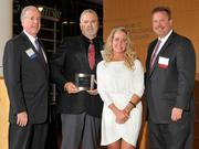 Charlie Foley (left) of sponsor Battelle & Battelle and Dave Donaldson (right) of sponsor WesBanco presented a second award to Jarod and Mari Wenrick of Value Added Packaging at the 2013 DBJ Manufacturing Awards Event at the Schuster Center.