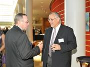 Mike Collinsworth of Custom Manufacturing Solutions speaks to a fellow guest at the 2013 DBJ Manufacturing Awards Event at the Schuster Center.