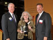 Charlie Foley (left) of sponsor Battelle & Battelle and Dave Donaldson (right) of sponsor WesBanco presented the award to Brenda Stansfield of Clear My Head! at the 2013 DBJ Manufacturing Awards Event at the Schuster Center.