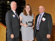 Charlie Foley (left) of sponsor Battelle & Battelle and Ken Maisch (right) of sponsor TechSolve presented the second award to Jennifer Behm of Projects Unlimited at the 2013 DBJ Manufacturing Awards Event at the Schuster Center.