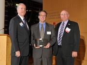 Charlie Foley (left) of sponsor Battelle & Battelle and Ken Maisch (right) of sponsor TechSolve presented the award to Kurt Forsthoefel of Midmark Corp. at the 2013 DBJ Manufacturing Awards Event at the Schuster Center.