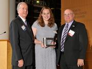 Charlie Foley (left) of sponsor Battelle & Battelle and Ken Maisch (right) of sponsor TechSolve presented the third award to Jennifer Behm of Projects Unlimited at the 2013 DBJ Manufacturing Awards Event at the Schuster Center.