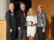 Charlie Foley (left) of sponsor Battelle & Battelle and Carol Clark (right) of the Dayton Business Journal presented the third award to Jarod and Mari Wenrick of Value Added Packaging at the 2013 DBJ Manufacturing Awards Event at the Schuster Center.
