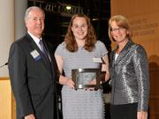 Charlie Foley (left) of sponsor Battelle & Battelle and Carol Clark (right) of the Dayton Business Journal presented the fourth award to Jennifer Behm of Projects Unlimited at the 2013 DBJ Manufacturing Awards Event at the Schuster Center.
